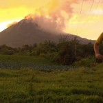 Richard Bowles running from Mt Sinabung  Photo by Andre Stamatakakos