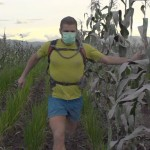 Richard Bowles runninng in crops near Mt Sinabung  Photo by Andre Stamatakakos