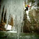 Rappelling in the snow and ice at the bottom of the canyon